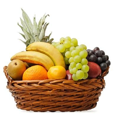 A Woven basket full of different fruit.